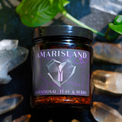 Candida Tea in Black and Purple Amarisland Jar Surrounded by Crystals