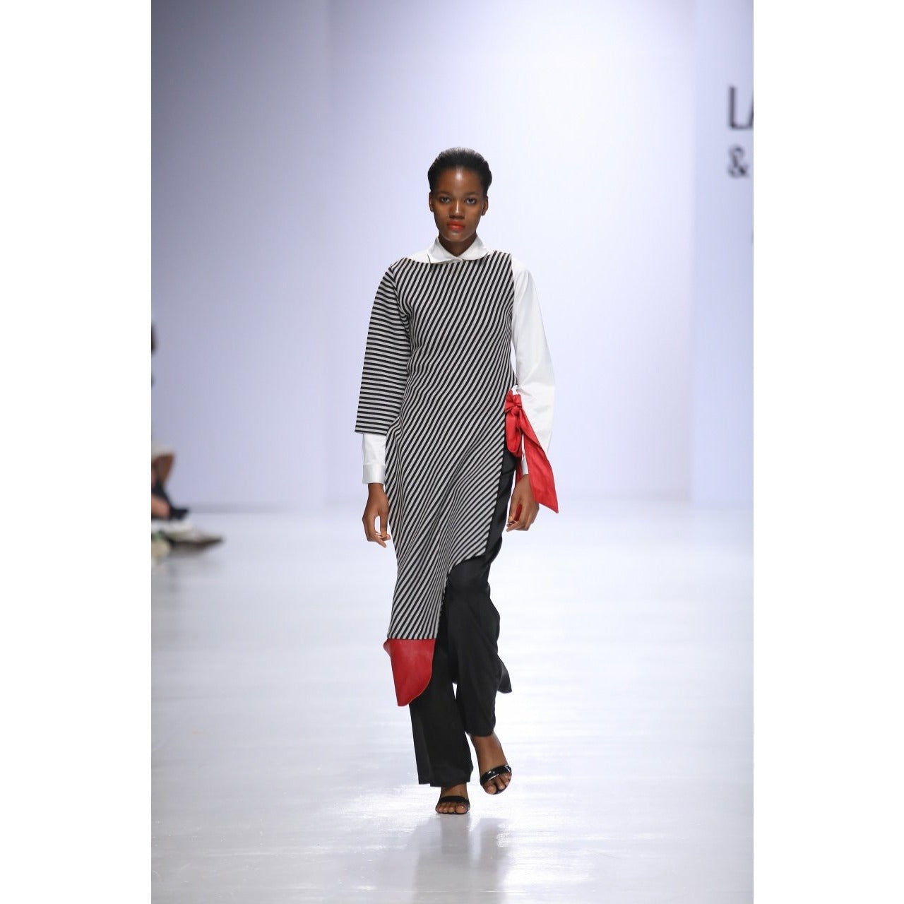 IDIA ASSYMETRIC HEM CAPE WITH LEATHER DETAIL