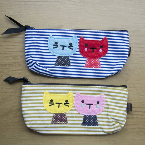 Fabric Cat Pencil Case.  Can be used for multiple things, pencils case, makeup bag, purse and more....   Choose from 4 designs: Beige Stripe,  Navy Stripe,  Red Stripe or Floral    Fully Lined  Zipper closure Ribbon on ip for easy opening/ closing Measures: 20.5cm x 8 cm x 3cm