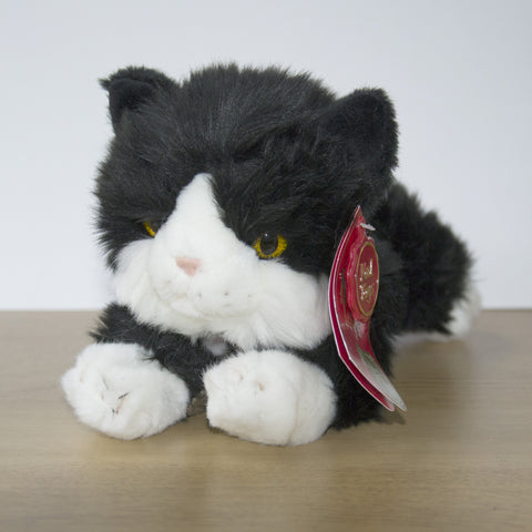 Black & White Cat Cuddly Toy. - Jinx  Measures 25cm long.  Super cute kitty.  Complete with collar and name tag. Clean with a damp cloth. Not suitable for children under 3. Cuddly Cat Toy for Cat Lovers