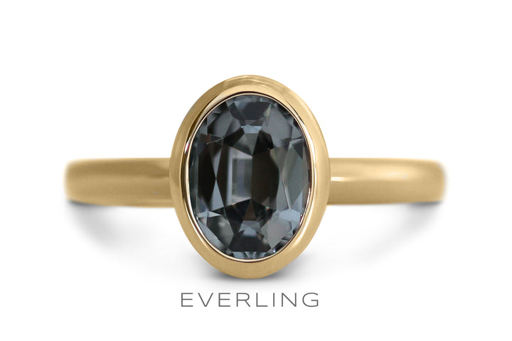 Custom designed grey spinel engagement ring set in recycled 18k yellow gold. www.everlingjewelry.com