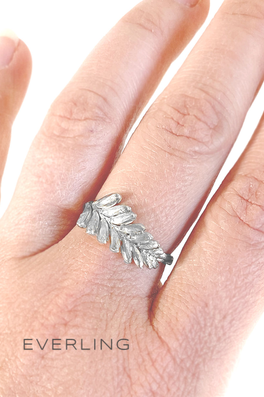 Sterling silver cast crocosmia flower band on the hand