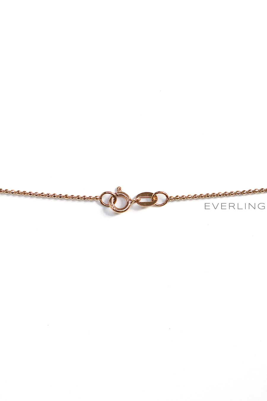 Back Detail- Recycled 14k Rose gold spike pendant with 9 flush set Canadian Sourced diamonds. www.EverlingJewelry.com