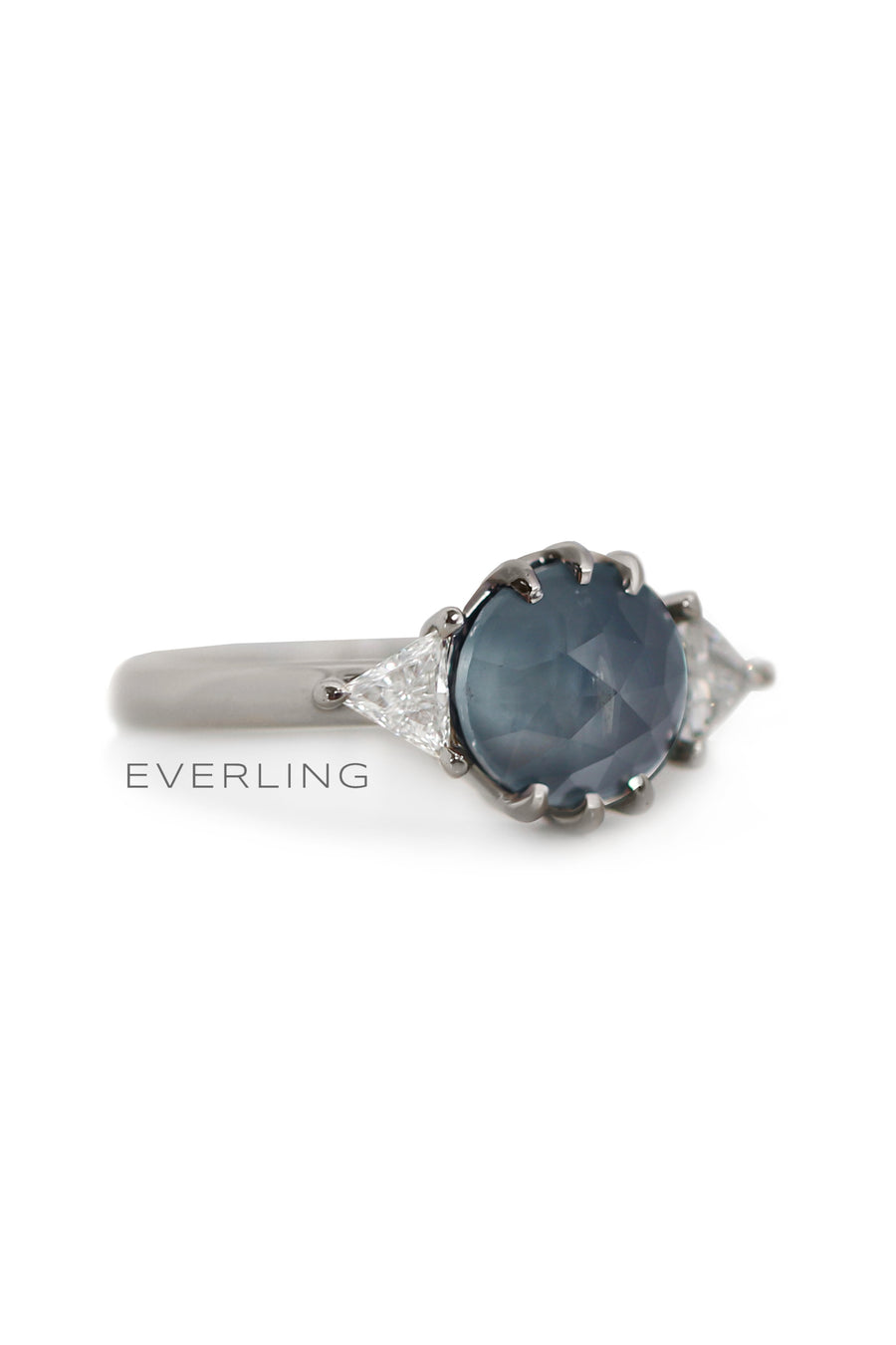 Recycled 18k palladium white gold ring with a rose cut Montana sapphire and Canadian sourced triangle diamonds. www.EverlingJewelry.com