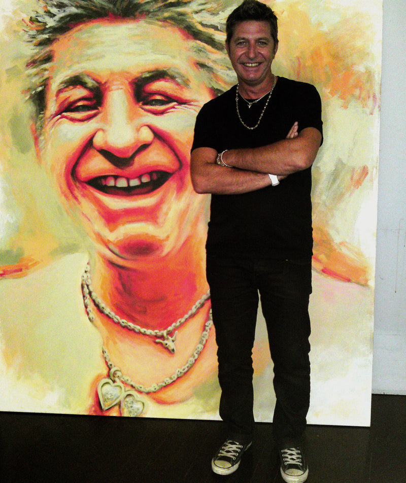 Australian fashion designer Wayne Cooper with his portrait by Sonya Rothwell for The Archibald Prize 2010