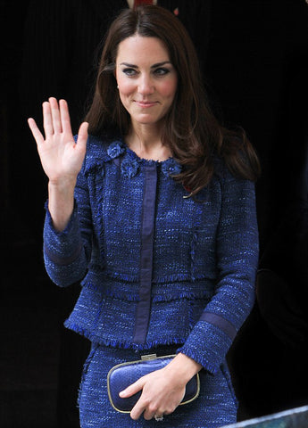 Kate Middleton wearing a tweed suit in shades of blue.