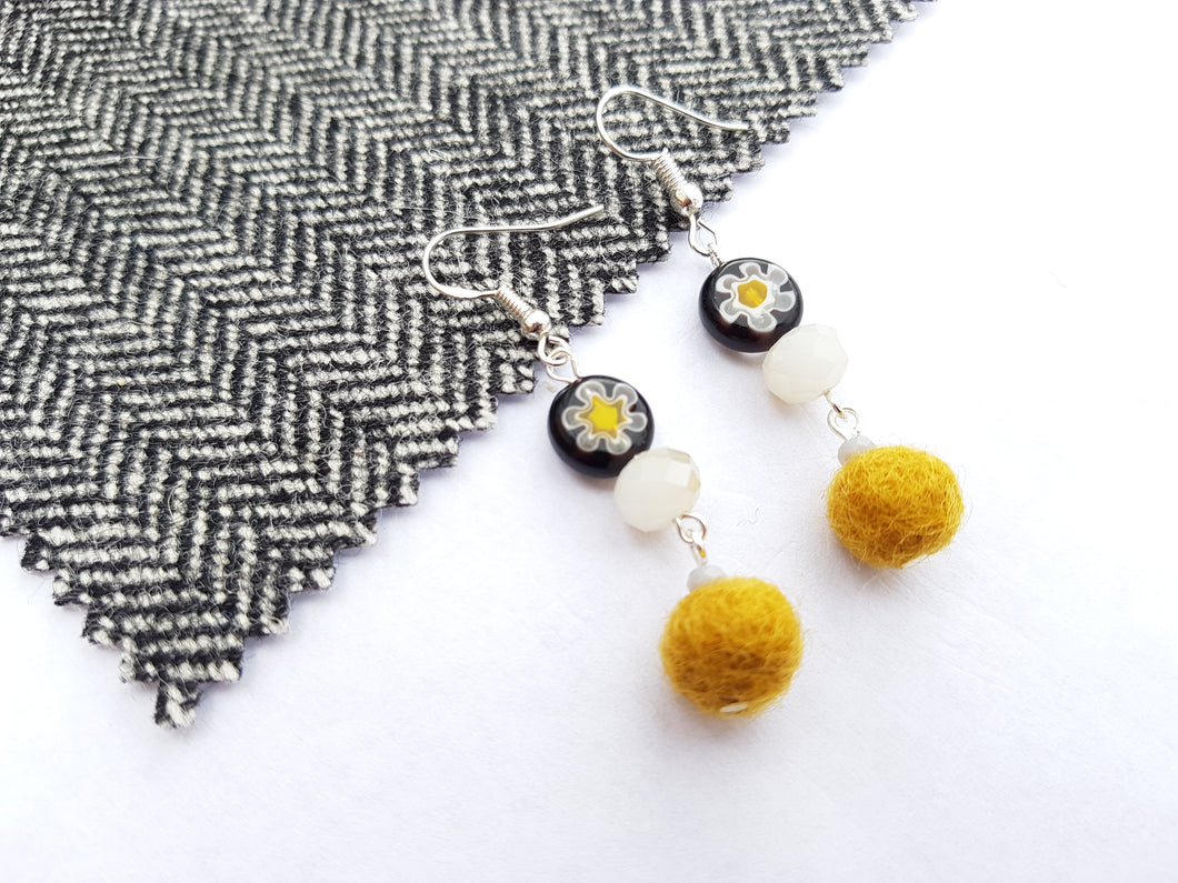 Black Daisy long drop earrings - Mustard