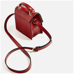 RED CLUTCH WITH STUDDED INSECTS VEGAN LEATHER - impaviid