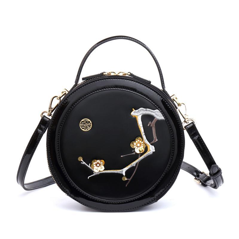 EMBROIDERED ROUND BLACK BAG CRUELTY-FREE