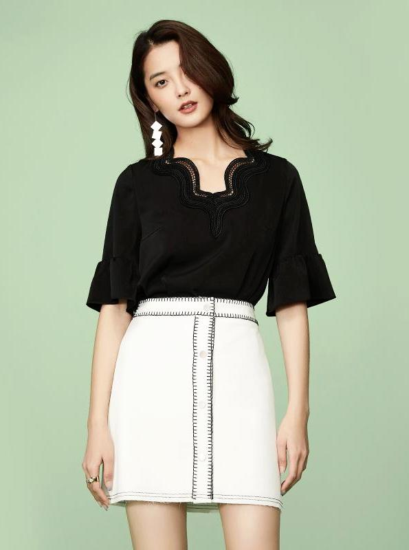 EXPOSED STITCHING BLACK AND WHITE MINI SKIRT - impaviid