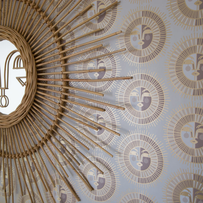 Ayo wall hanging hung on top Ayo Wallpaper in Gold by Justina Blakeney® exclusively at Jungalow®