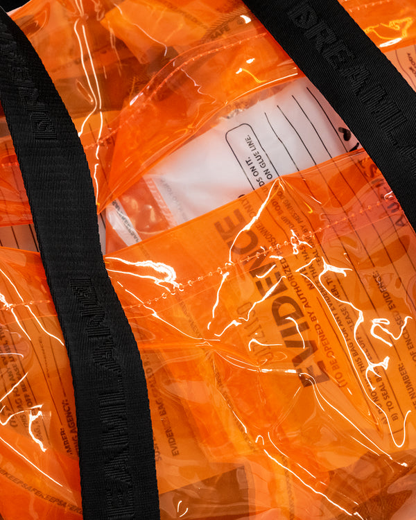 ORANGE PLASTIC DUFFLE WITH BLACK STRAPS