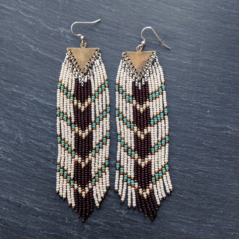 Long native seed bead earrings with a chocolate brown and blue chevron design. Free shipping in the US.