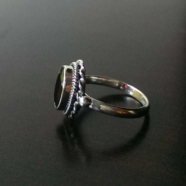 Moon & Milk - 925 sterling silver oval garnet ring with two delicate twisted rope designs around the frame