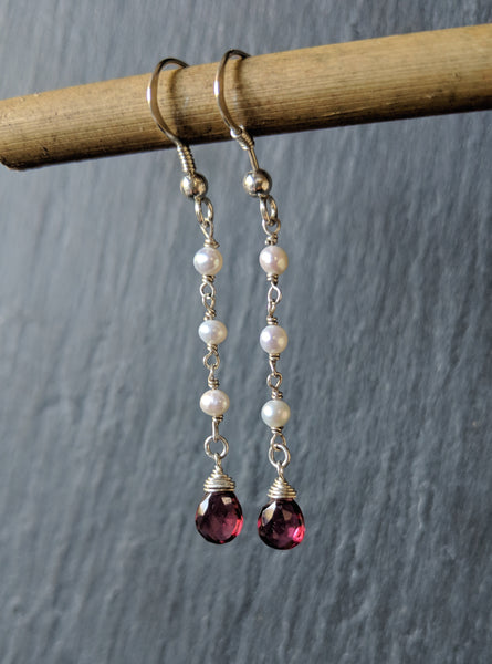 Rosary style earrings with three small pearls and wire-wrapped rhodolite garnet briolette gemstones