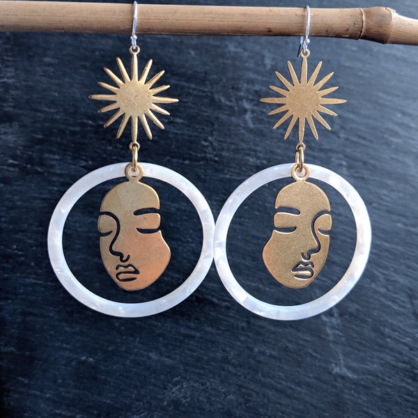 Large silk white tortoise hoop earrings with a Picasso face figure