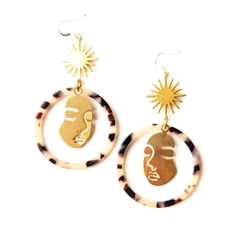 Moon & Milk - large tortoise hoop earrings with a Picasso face figure silhouette and a golden star charm.