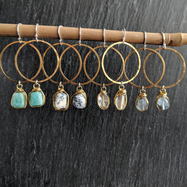 Moon & Milk - Handmade and hammered antique brass hoop earrings with wire-wrapped gemstone nuggets in different gemstones. Available in amazonite, dendrite, citrine, and aquamarine.