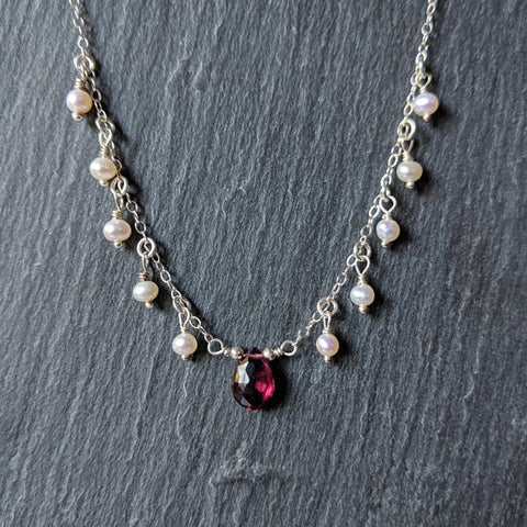 Handmade sterling silver chain drop necklace with a rhodolite garnet briolette and tiny pearls