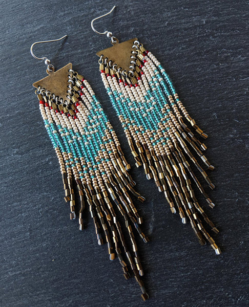 Moon & Milk - Handcrafted long native beaded earrings with 5 different layers of colors: red, pearl white, aqua, gold, and iris bronze. Created with glass beads, antique brass, and sterling silver