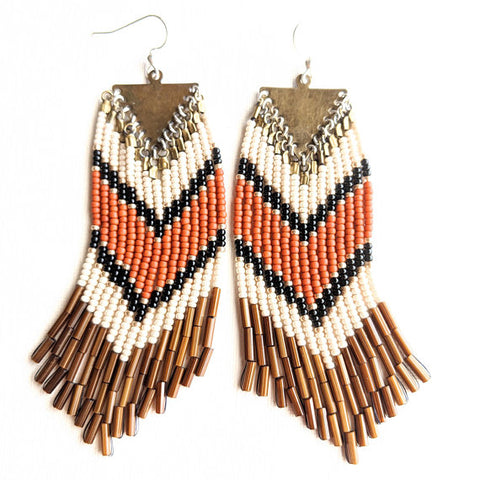 Moon & Milk- Orange and gold bohemian earrings with brown fringes and a chevron design.