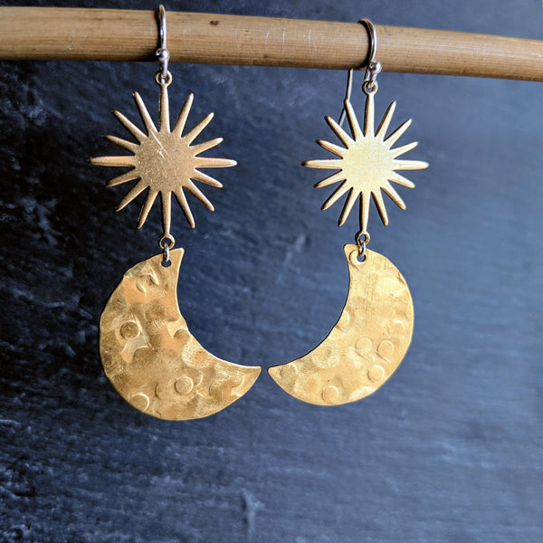 Moon & Milk - Golden raw brass earrings with a woman face figure and a sunburst charm. Always handcrafted with love.