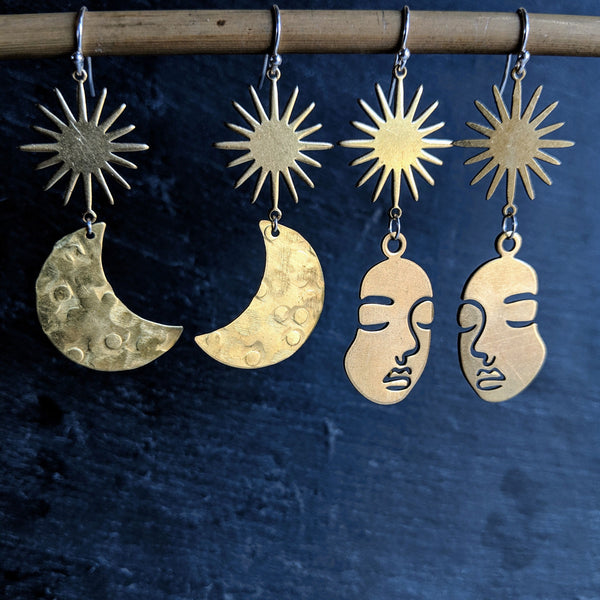 Moon & Milk - Raw brass crescent moon and hammered earrings with a sunburst charm. Also available in Picasso face figure.