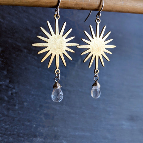 Gold brass star earrings with wire-wrapped teardrop quartz gemstones. Free shipping in the US.