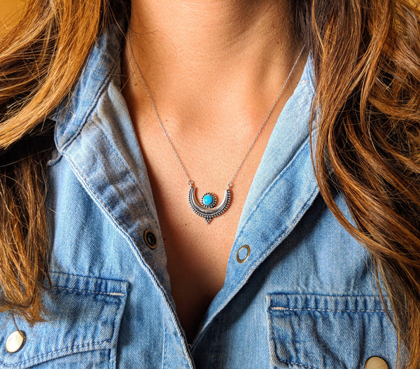 Moon & Milk - A crescent moon pendant necklace with a natural turquoise stone bezel setting and a silver c