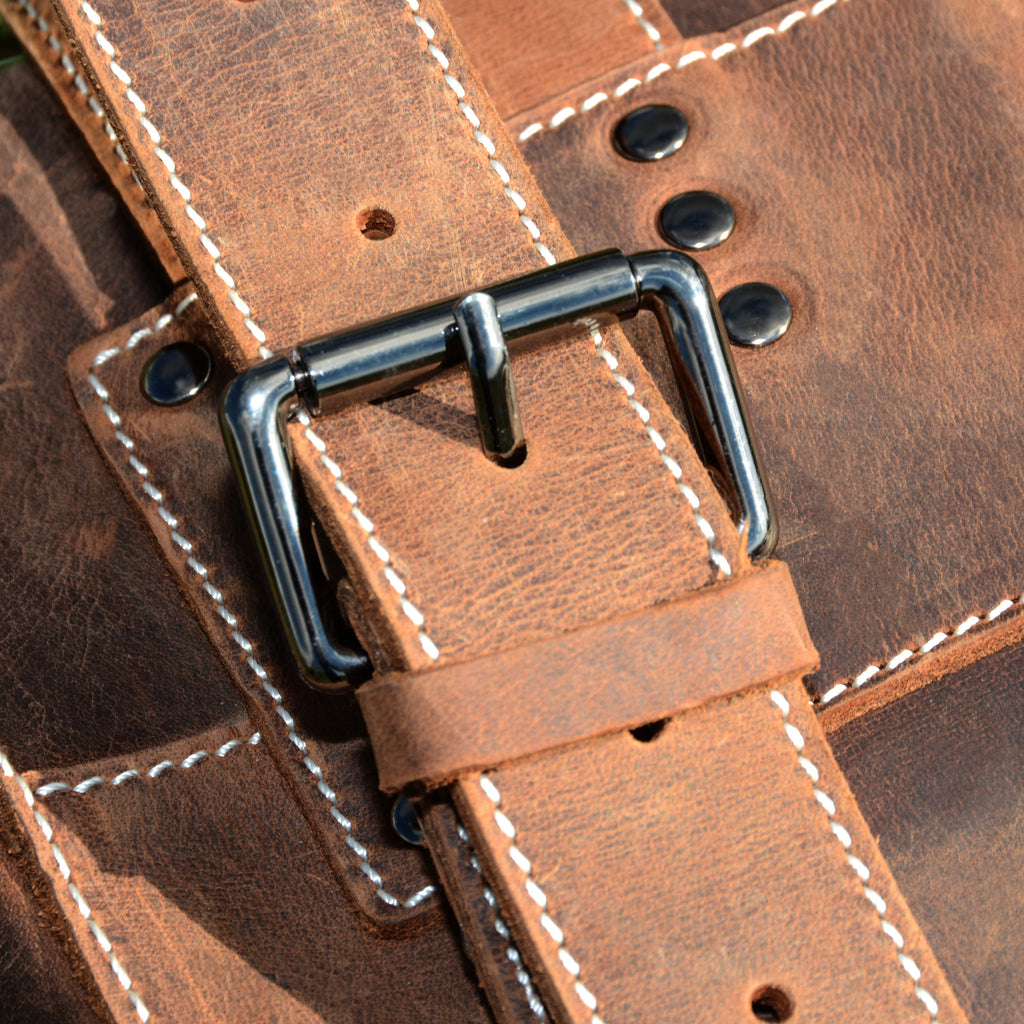 Buckle on the Leather Backpack