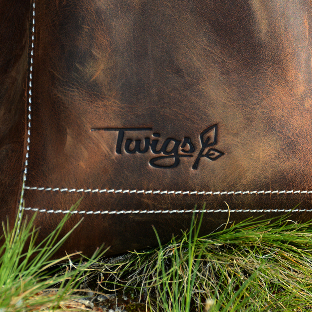 Twigs logo on the Leather Backpack