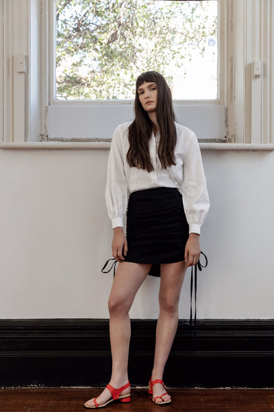 kalaurie white deadstock cotton bishop sleeve statement shirt with black linen viscose draped mini skirt ethically and sustainably made in melbourne
