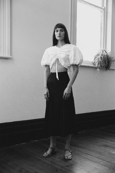 kalaurie white deadstock cotton puffy sleeve blouse with black linen viscose high waisted split skirt ethically and sustainably made in melbourne