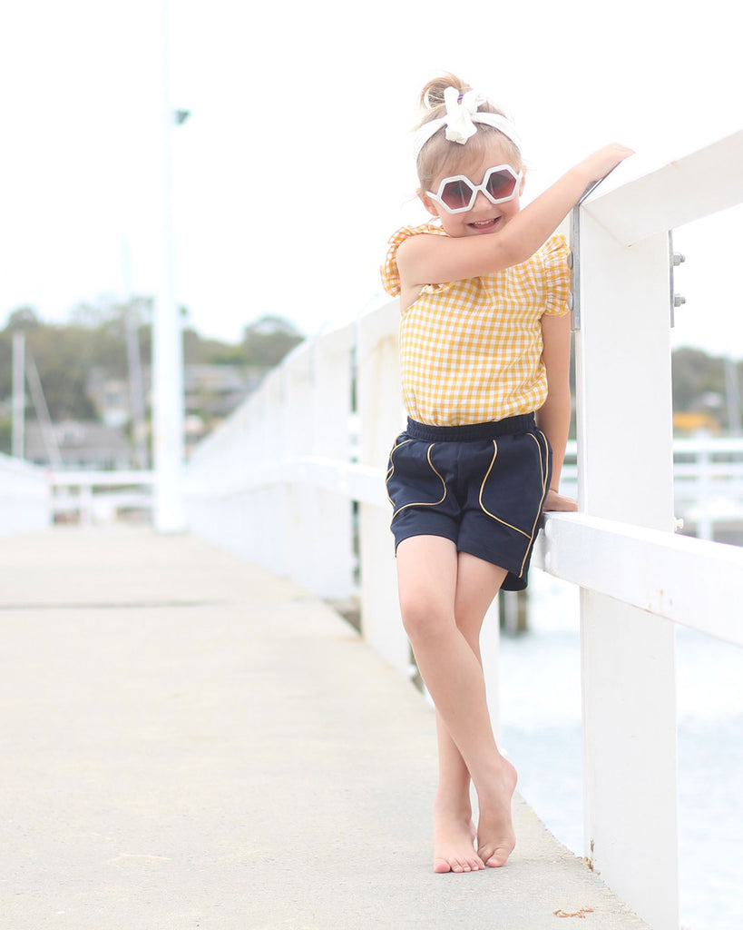 Mini Ruffle Gingham Top in Yellow on model