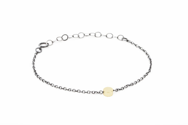 Simple bracelet with shiny gold bead & oxidized silver chain