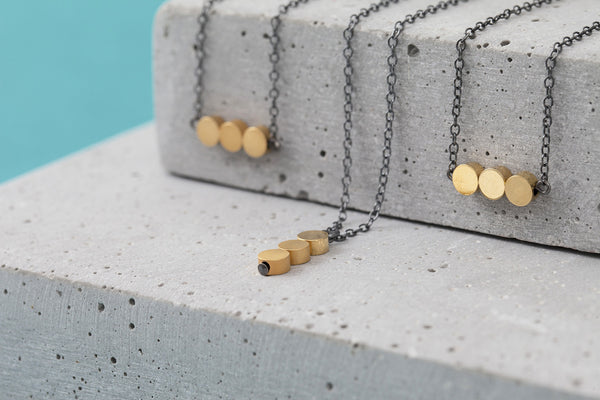 Contrast necklace in oxidized silver, matte silver & oxidized brass