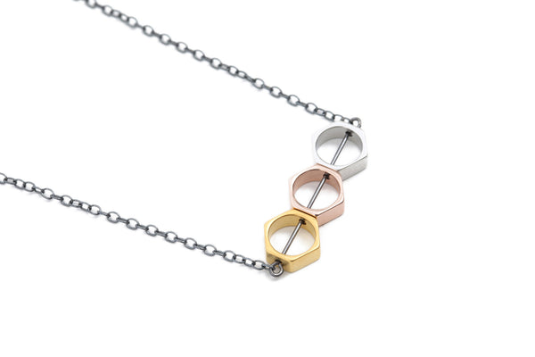 Matte gold, rose gold & matte silver hexagon necklace