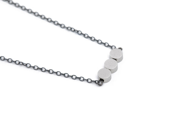 Necklace w. matte silver circle beads & oxidized silver