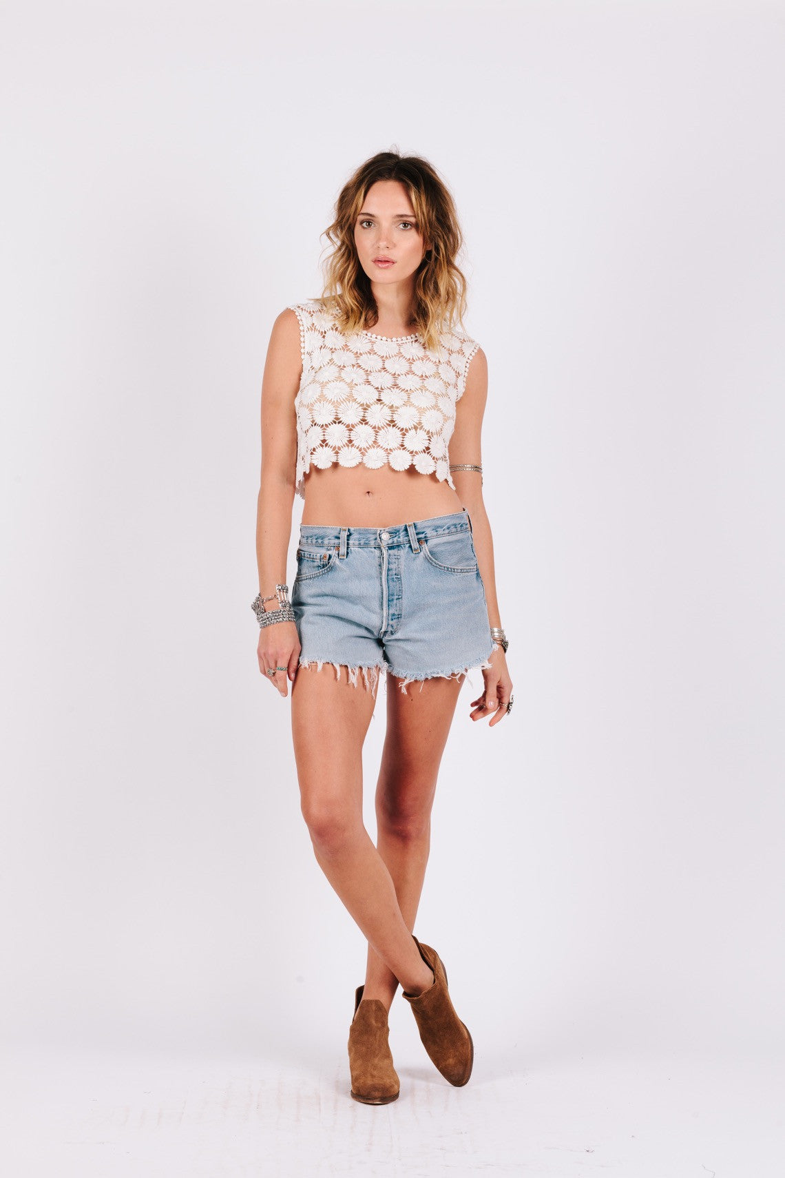 "Lazy Daisy Crop Top-Women - Apparel - Shirts - Blouses-Product Details This piece is 100% cotton Unlined, crop style top Model is wearing a size S Measures approximately 16"" from top of shoulder to bottom hem Model is 5'11"" with 34"" bust, 24"" waist, and 35"" hips All sale items are Final Sale Easy Measure Conversion XS/0 S/1 M/2 L/3 US 0/2 2/4 6/8 8/10 AUS 4/6 6/8 10/12 12/14 BRAZIL 34/36 36/38 40/42 42/44 CHINA 76a/80a 80a/84a 88a/92a 92a/95a EUP 32/34 34/36 38/40 40/42 JAP 5/7 7/9 11/13 13/15 R"