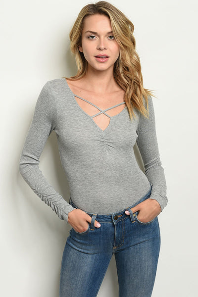 "Grey Bodysuit-Women - Apparel - Shirts - Blouses-Product Details Long sleeve neckline detail ribbed bodysuit. Country: GUATEMALAFabric Content: 95% RAYON 5% SPANDEXSize Scale: S-M-LDescription: L: 28"" B: 30"" W: 26""-Keyomi-Sook"