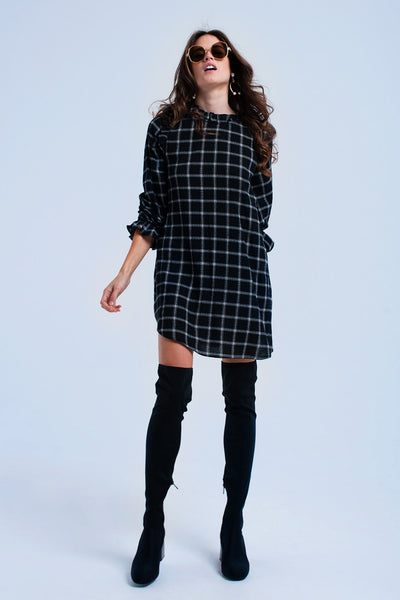 Black Checked Dress-Women - Apparel - Dresses - Day to Night-Product Details Black pure cotton mini dress with checked pattern. It has a round neck, a round hem, long sleeves with elastic cuffs and an open back detail with button closure. It also has frills in the neckline, in the shoulder line and in the cuffs and two concealed pockets in the front.-Keyomi-Sook