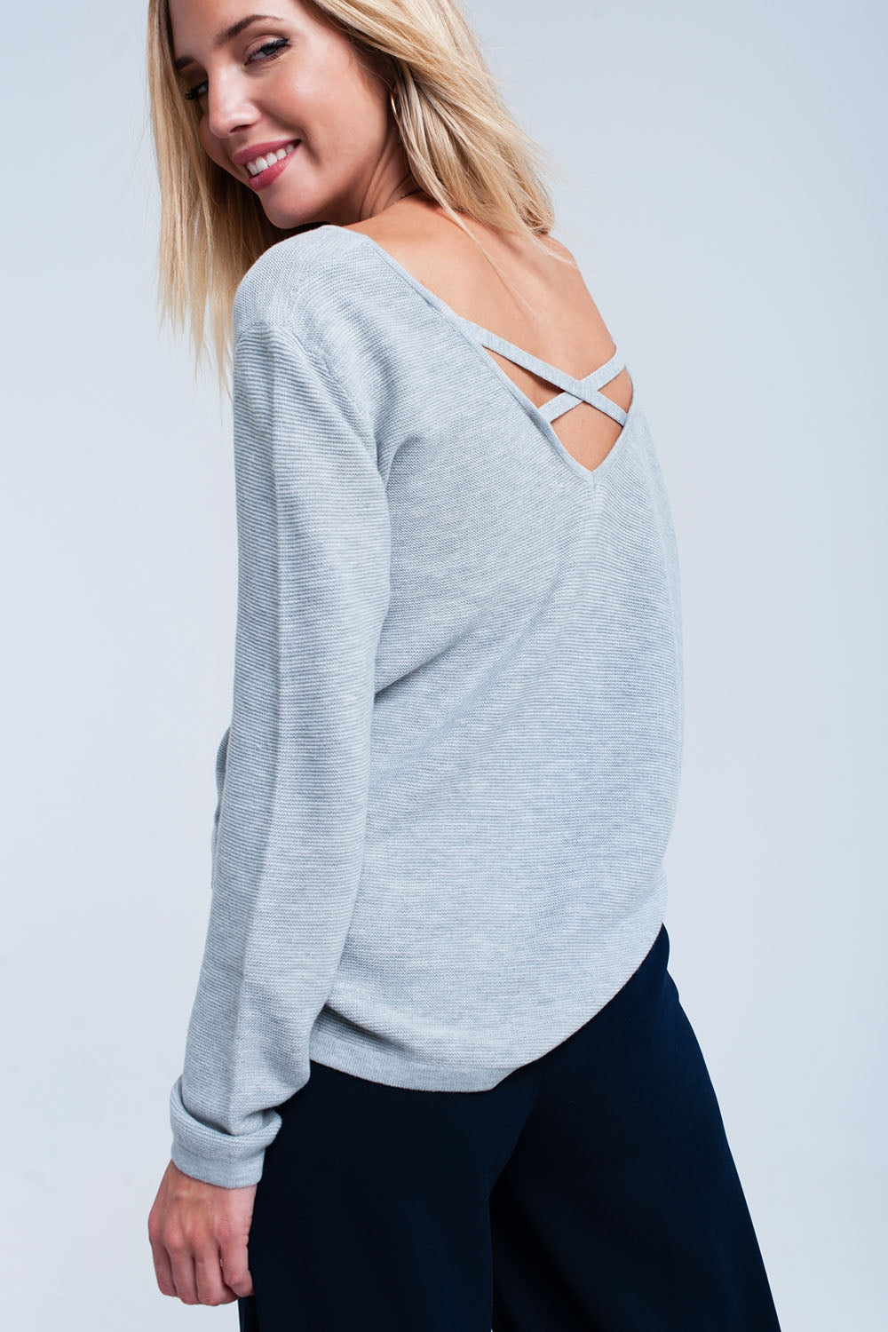 Light Gray Ribbed Sweater-Women - Apparel - Sweaters - Pull Over-Product Details Gray ribbed sweater with a V neck and cross back detail to the neck. It has long sleeves and side slits to the hem. Soft woven.-Keyomi-Sook