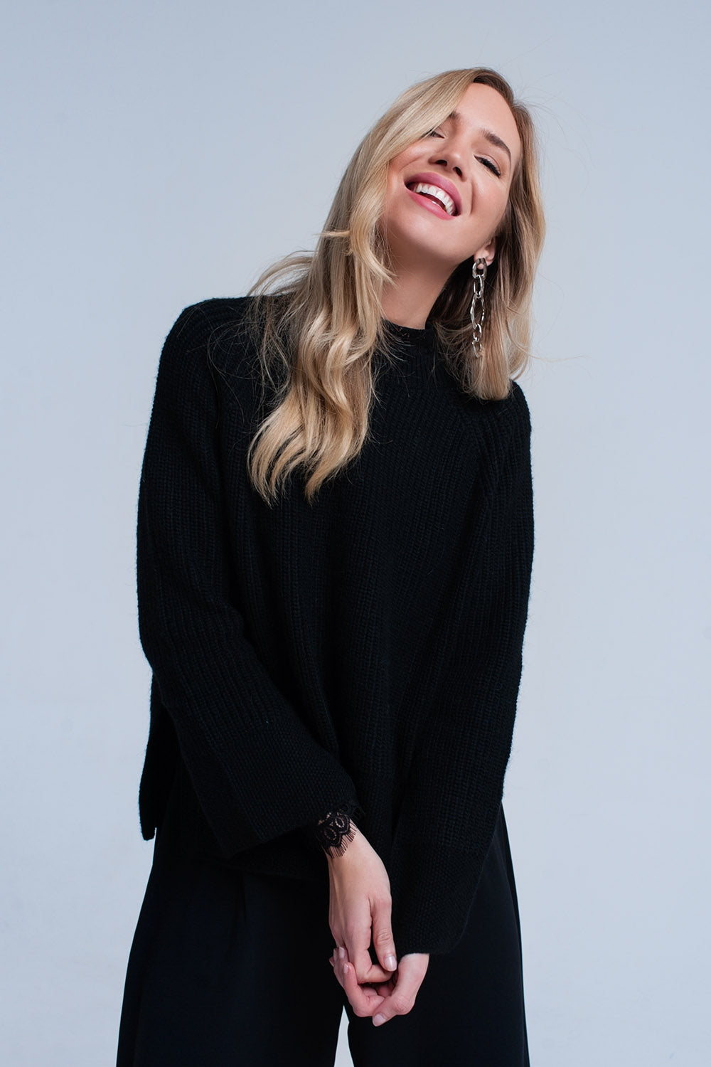 Black Knitted Sweater With Open Side Detail-Women - Apparel - Sweaters - Pull Over-Product Details Black knitted sweater with a crew neck, long sleeves and an asymmetric hem. There are slits in the hem and cuffs.-Keyomi-Sook