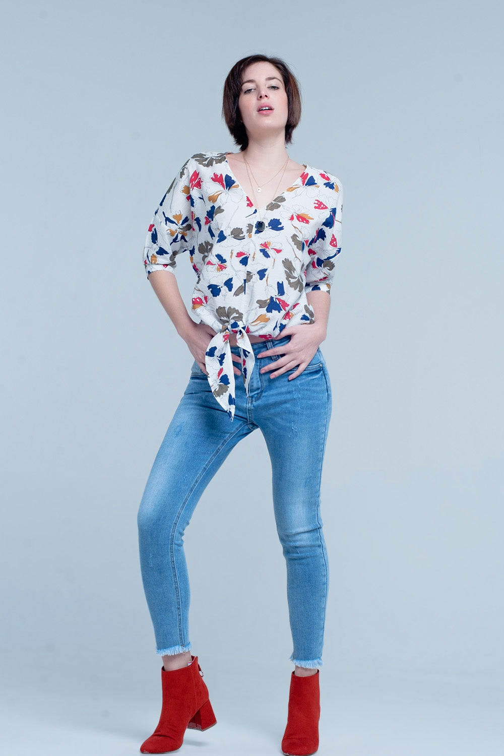 White Floral Tie Front Top-Women - Apparel - Shirts - Blouses-Product Details White floral top made of light and airy viscose this top has sleeves with a cufflink it has a v neck and the top can be tied at the front-Keyomi-Sook