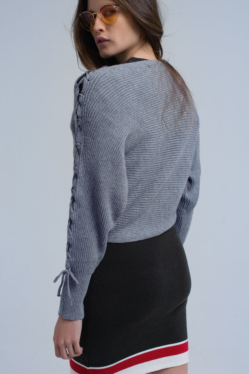 Gray Crop Sweater With Tie Ribbons-Women - Apparel - Sweaters - Pull Over-Product Details Crop sweater in gray. It has a round neck, a round hem and long sleeves. There are ribbons on the sleeves that start on the shoulder line and finish tied on the wrists. It is in ribbed woven fabric.-Keyomi-Sook