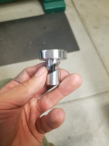 Aluminum handlebar ends for an Indian Scout motorcycle.