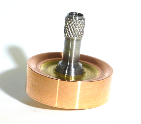Copper, brass and stainless steel spinning top