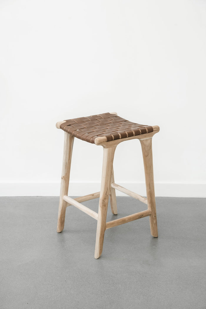 Comfortable, casual, leather-strapped counter height Backless Woven Leather Counter dining stool in Saddle. Handmade in Bali using Teak wood and vegetable-tanned leather imported from Java. - Saffron and Poe
