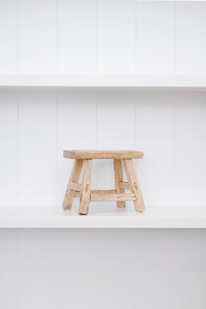 Petite rectangle stool on white shelf with white background. - Saffron and Poe