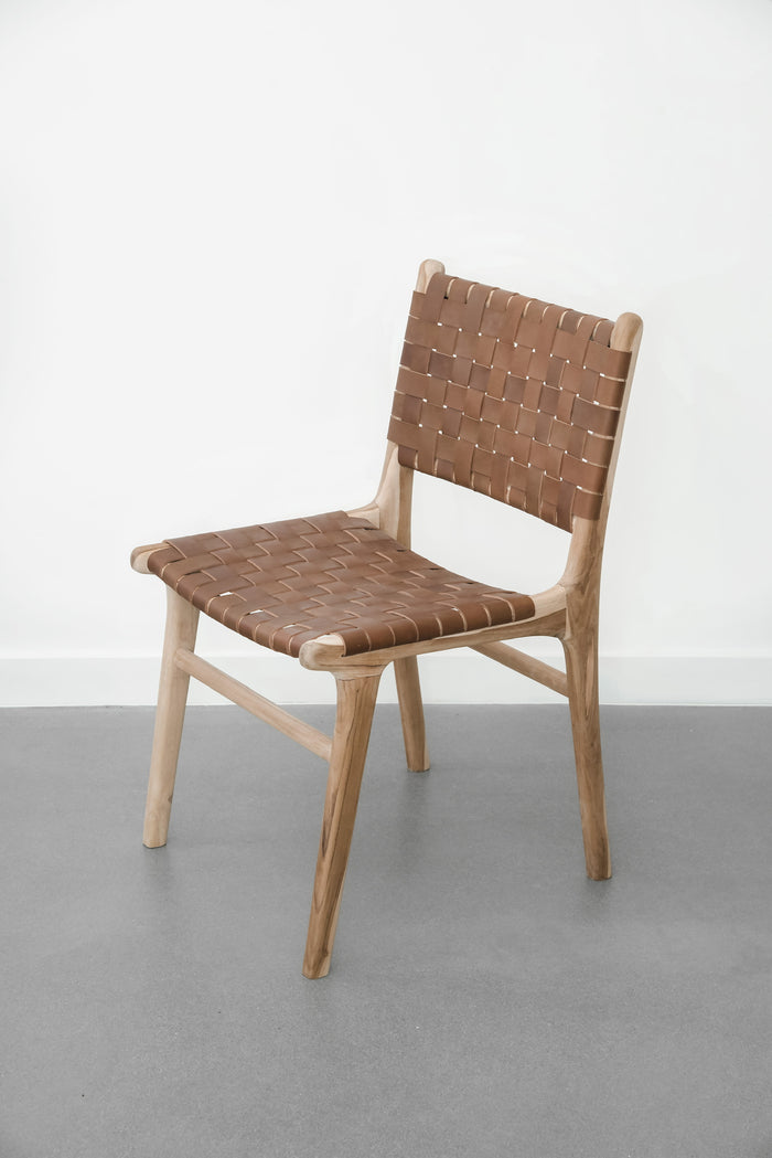 White background with our Woven Leather Strap Dining Chair - Saddle. Handmade in Bali with Teak wood and vegetable-tanned leather imported from Java. - Saffron and Poe